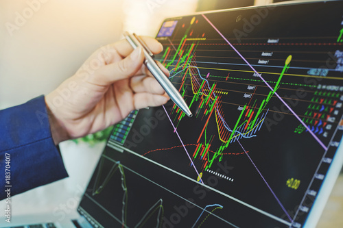 Fotomural top view of business people working with stock trading forex with technical indi