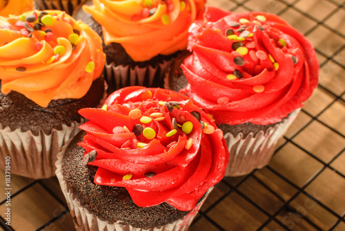 Photo  Fall Cupcakes in bright red and yellow colors with sprinkles