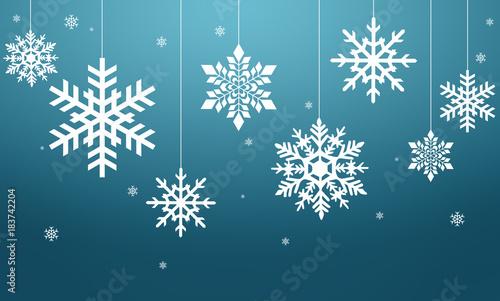 Fototapeta Białe płatki śniegu na niebieskim tle obraz