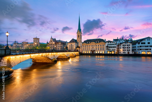 Panoramic view of historic Zurich city center with famous Fraumunster Church and river Limmat at Lake Zurich , in twilight, Canton of Zurich, Switzerland Canvas-taulu