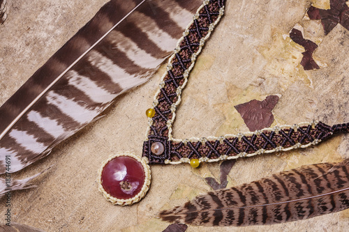 Photo Stands Ship Natural gemstone handmade macrame meterial necklace with wild feather background