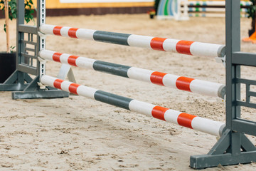 Show jumping barriers on the ground. Arena for equestrian sports