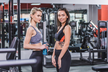young athletic women in modern sportswear at gym