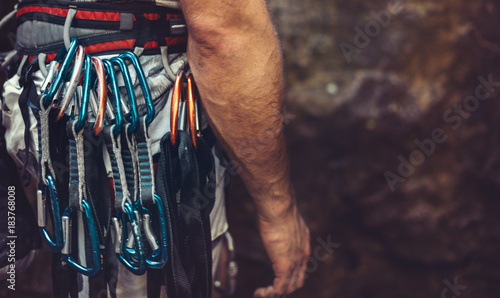 Photo sur Aluminium Alpinisme Man standing with climbing equipment outdoor, rear view. Face is not visible