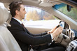 Businessman in driver's seat of car