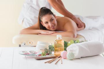 Obraz na płótnie Canvas picture of happy beautiful woman in massage salon