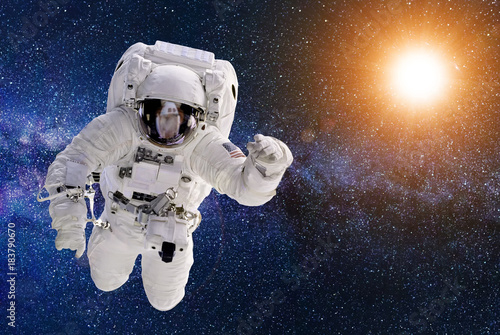 Astronaut in outer space - elements of this image furnished by NASA