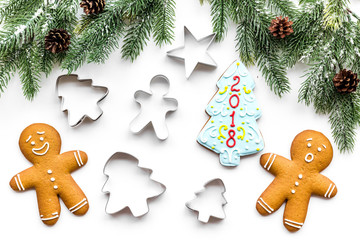 Make gingerbread cookies for New Year at home. Bakery and cutters on white background top view