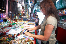Woman Looking At Souvenirs On Market Stall, Bangkok, Krung Thep, Thailand, Asia