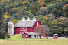 Large Red Barn And Hillside