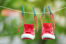 Pair Of Red Sneakers Hanging O...