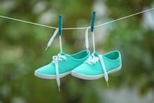 Pair Of Turquoise Sneakers Han...