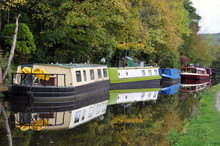 Barges And Houseboats Moored A...