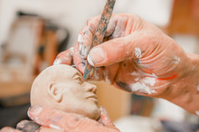 Close Up Of Man Ceramist Hands...