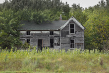 Front View Of An Abandoned Far...