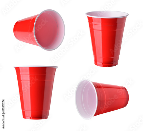 Obraz Red plastic party cups set, isolated on white background - fototapety do salonu