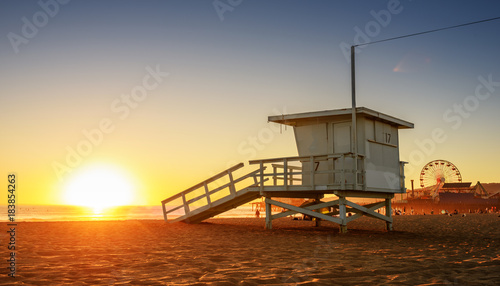 Santa Monica beach lifeguard tower in California USA at sunset