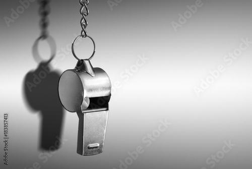 Valokuva Hanging metal whistle closeup photo