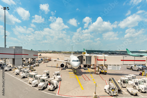 Fényképezés  A modern European aerodrome with aircraft serving aircraft and technical personn