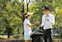 Young Businessman And Caddy Pl...