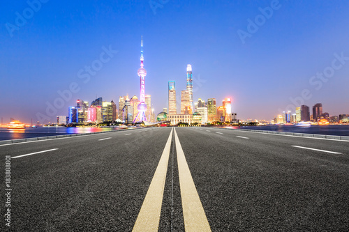 Asphalt road and modern city famous architectural scenery in Shanghai at night,C Poster