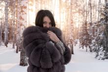 Girl In A Fur Coat Against A B...