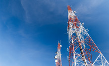 Communication Tower On Blue Sk...