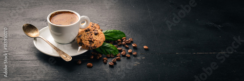 Cadres-photo bureau Cafe Coffee and oatmeal chocolate cookies on a wooden background. Coffee beans. Top view. Free space for text.