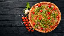 Pizza Primavera. Cherry Tomatoes, Arugula, Cheese. On A Wooden Background. Top View.