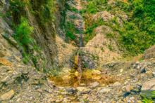 Small Orange Waterfall In Moun...