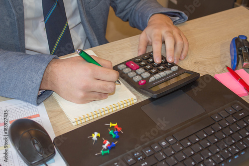 Administrator man financial inspector and secretary making report, calculating or check balance. Internal Revenue Service inspector checking document. Audit concept