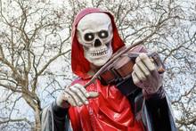 Grim Reaper, A Skeletal Figure...