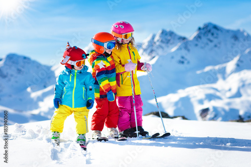 obraz dibond Ski and snow winter fun for kids. Children skiing.