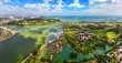 Leinwanddruck Bild - Panorama view of Singapore City skyline in Singapore. Bird eyes view of The Supertree Grove, Cloud Forest & Flower Dome at Gardens by the Bay on August 29,2016 in Singapore. Spanning 101 hectares.