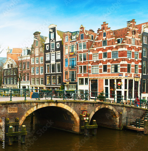 Poster Amsterdam Prinsengracht Canal and typical Dutch houses behind the bridge in winter, Amsterdam, The Netherlands. .