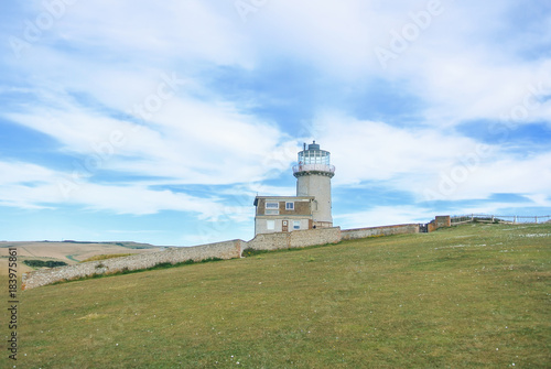 Fotografie, Obraz  Belle Tout Lighthouse on summer cloudy day, Seven Sisters country park, Eastblurne, East Sussex, England, UK