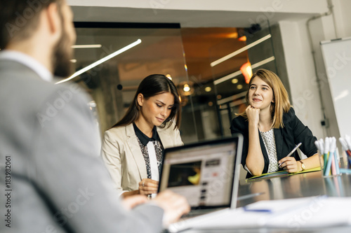 Fototapety, obrazy: Young women working in office
