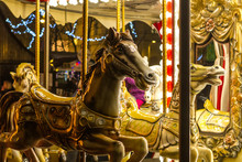 Antic Retro Carousel With Golden Horses Mirrors And Lamps