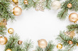canvas print picture - Christmas frame, pattern made in gold colors and and gold glass Christmas balls on white background with empty copy space for text. Holiday and celebration concept. Top view. Flat lay