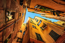 Traditional Houses In A Narrow Street In Genoa, Italy