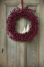 Berry Wreath On A Wooden Door