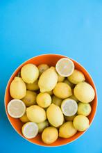 Lemons Sitting In An Orange Bowl