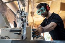 Carpenter Polishing A Piece Of...