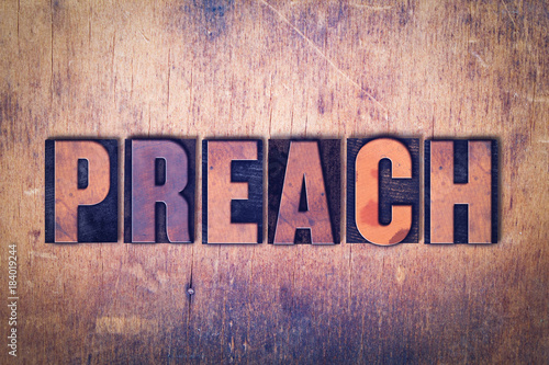 Valokuva  Preach Theme Letterpress Word on Wood Background