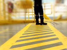 Walkway Lane In The Offshore Oil Rig With Worker Between Parallel Yellow Lines