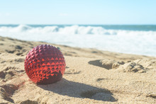 Red Christmas Ball In The Sand...