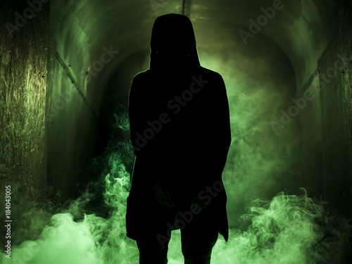 Silhouette of a man in fog green light Wallpaper Mural