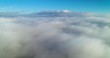 Aerial wiev: Amazing Flying over the Clouds of Fog, above the City