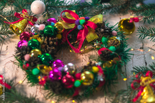 Fototapety, obrazy: Christmas wreath of Christmas tree branches on a white wooden background.