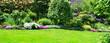 Leinwandbild Motiv Gartenanlage Panorama Frühling
